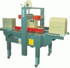 Maquina cerradora de cajas con cinta adhesiva